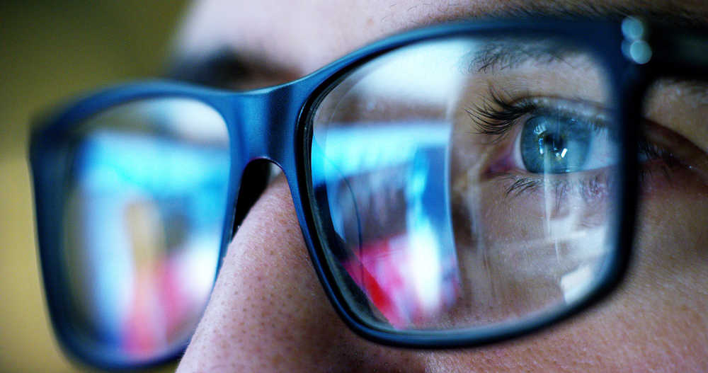 man looking with glasses at why is important to have a good online reputation