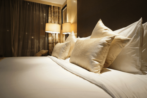 comfortable bed and pillows