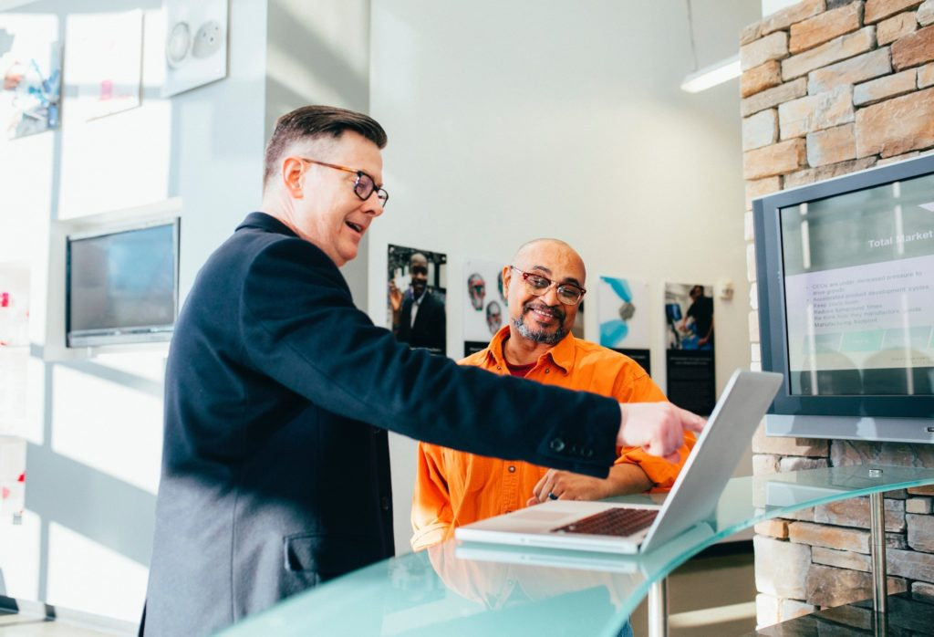 net reputation - two men pointing at laptop