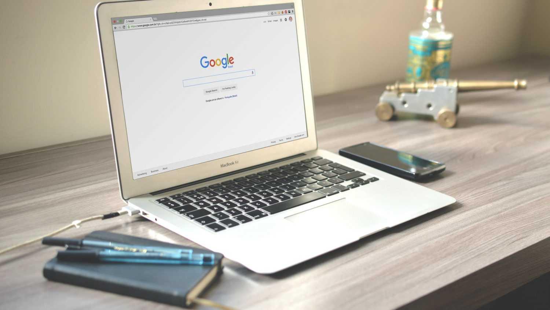 laptop on Google on clean wooden desk