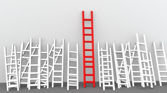 red ladder next to white ladders showcasing competitive advantage