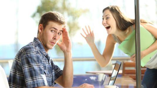 Embarrassed Guy ignoring girl in window