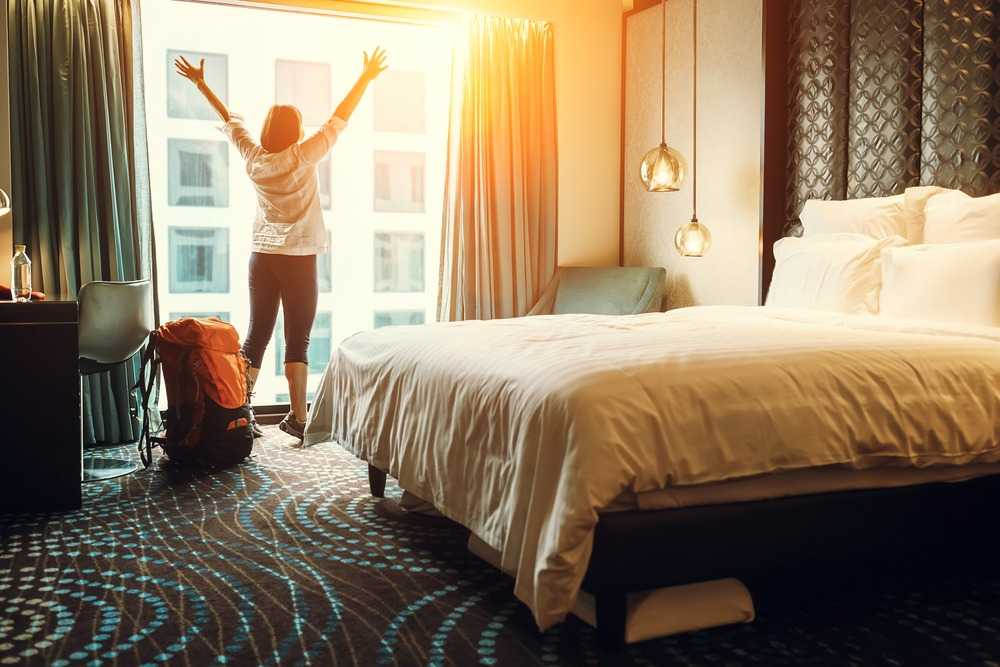 woman stretching in hotel room
